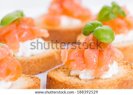 Close up on canapes with smoked salmon and cream cheese