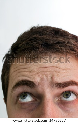 Close-up on confuse man looking up - stock photo