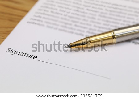 close-up on contract paper with pen - stock photo