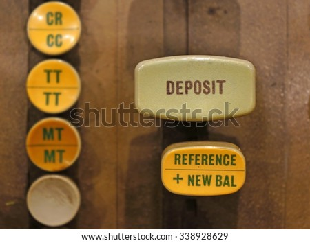 Close up on Deposit button on old automated banking machine. - stock photo