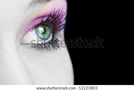 Close up on female eye with colorful makeup - stock photo