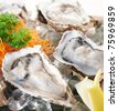 close-up on fresh and delicious raw oysters - stock photo