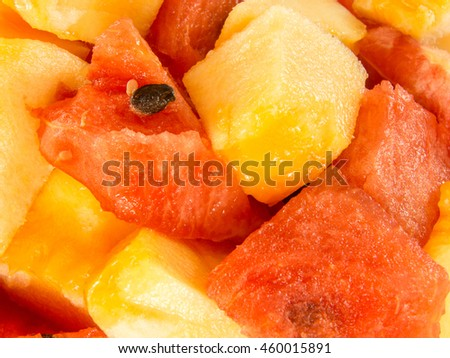 close up on fresh ripe delicious watermelon and yellow melon chops - stock photo