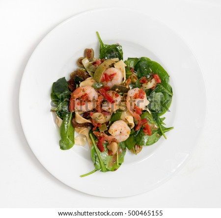 close up on fresh salad of prawns, baby spinach and chili,  top view