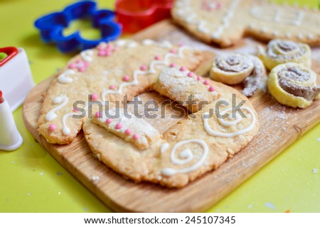 close up on gingerbread house over wooden desk green background - stock photo