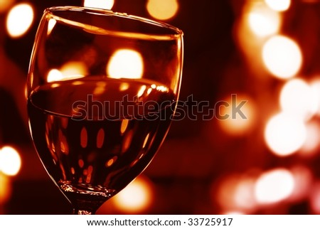 Close up on Glass of Red Wine with Lights Background. - stock photo