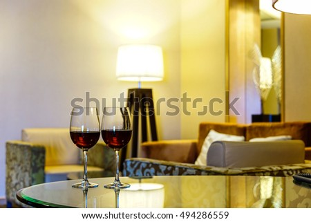 Close up on glasses of red wine in Modern living room.