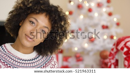 Close up on grinning woman near Christmas tree