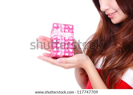 Close up on hand presenting gift box and smiling christmas woman isolated on white background, asian beauty model