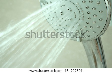 close up on head shower while running water - stock photo