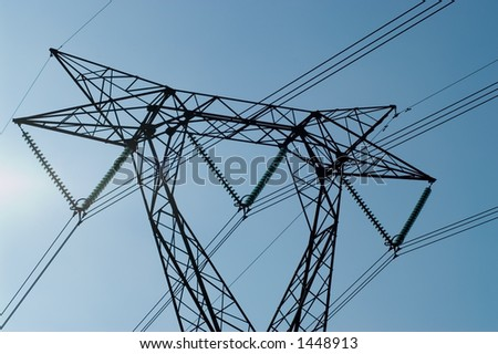 Close up on high part of electrical pylone - stock photo