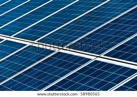 Close-up on large solar panels in photovoltaic park - stock photo