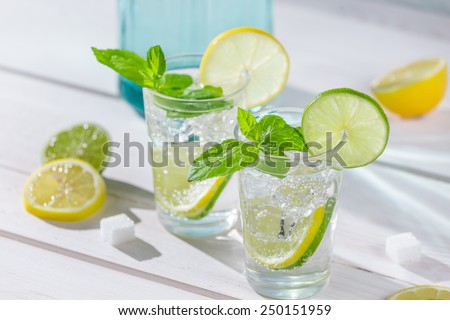 Close-up on lemon drink with ice - stock photo