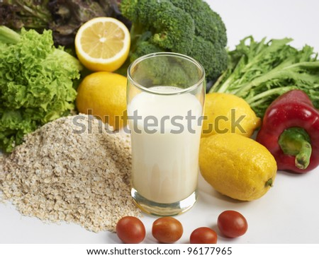 close-up on milk and vegetable with white background - stock photo