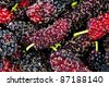 Close up on Mulberries background - stock photo