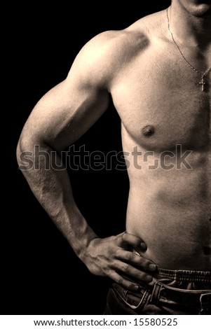 Close-up on muscular man isolated on black background - stock photo