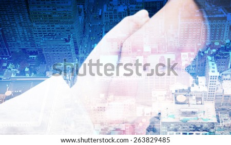 Close up on new partners shaking hands against new york - stock photo