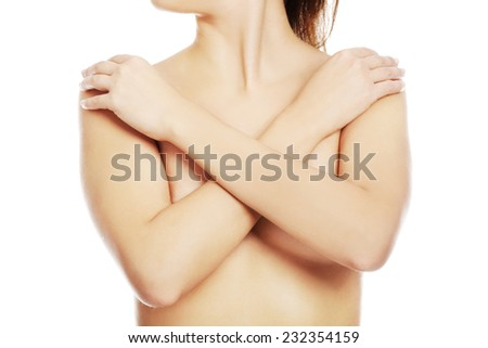Close up on nude woman covering her breast. - stock photo
