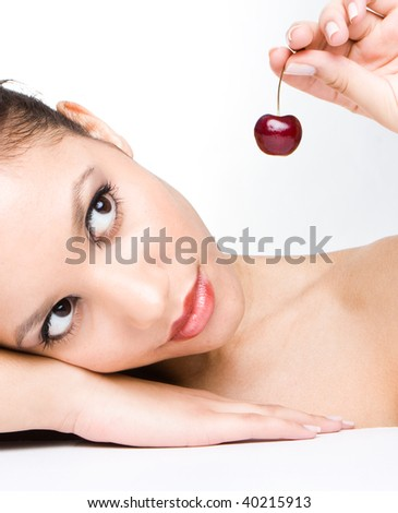 close up on of a sensual happy beauty girl playing with  cherries - stock photo