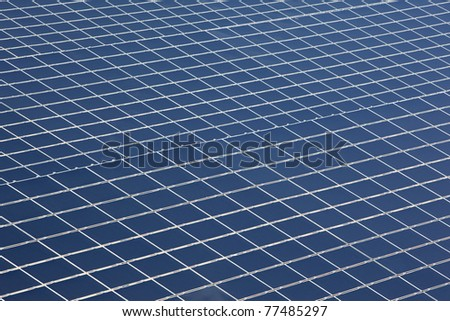Close up on photovoltaic panel in a solar power plant