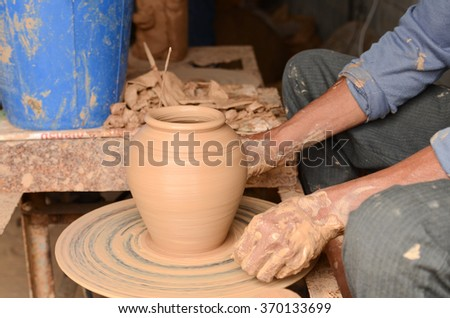 Close-up on potter making a ceramics jar near the town of Ban Tha Hai in Ubonratchathani, Thailand