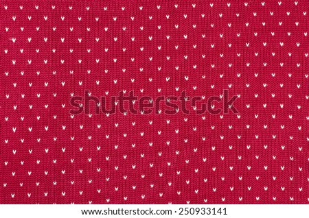 Close up on red and white dots woolen texture. Knit shapes pattern as a background. - stock photo