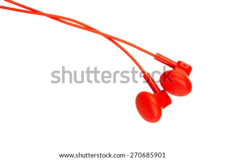 Close up on red earbuds isolated on white background - stock photo