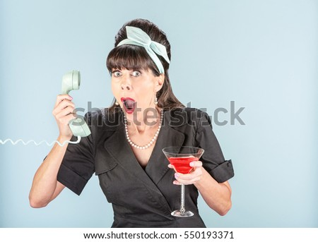 Close up on shocked retro woman in black dress with vintage phone receiver