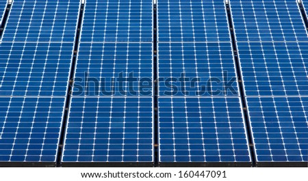 Close up on solar panels used to help create electricity.  - stock photo