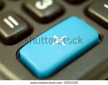 close up on the big plus key of a calculator - stock photo