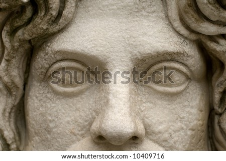 Close-up on the empty eyes of a Roman statue. Eyes are a window to the soul. - stock photo