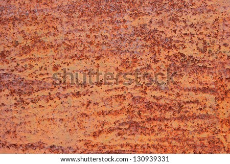 Close up on the old metal oxide texture background - stock photo