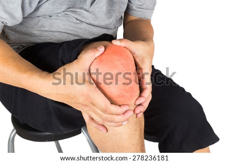 Close up on the painful knee joint of a matured man - stock photo