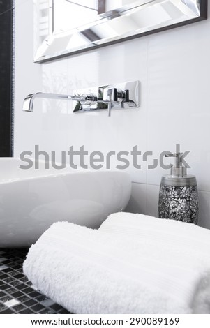 Close-up on towels and tap in luxury bathroom - stock photo