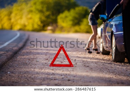 Close up on triangle warning sign outdoor - stock photo