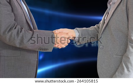 Close up on two businesspeople shaking hands against business online on digital screen - stock photo