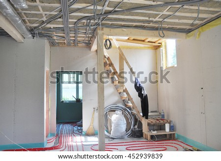 Close up on water floor heating system, interior walls insulation and soundproofing. Interior Room Construction. - stock photo