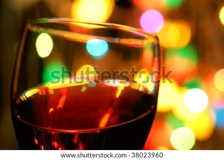 Close up on wineglass with Colorful Lights. - stock photo