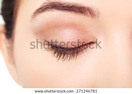 Close up on woman eye with an artistic makeup. - stock photo