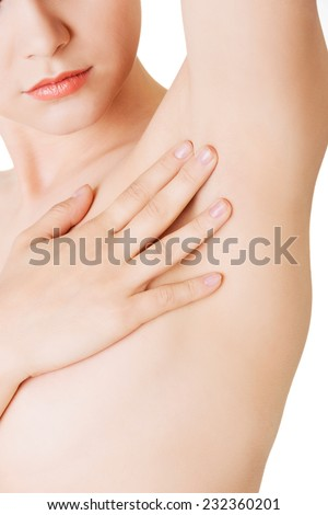 Close up on woman touching an armpit. - stock photo