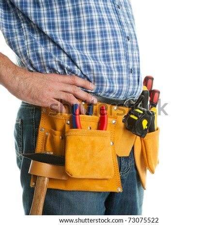 Close-up on worker's toolbelt - stock photo