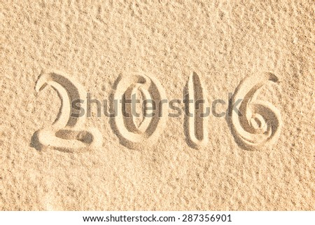 Close up on 2016 written in the sand of a beach - stock photo