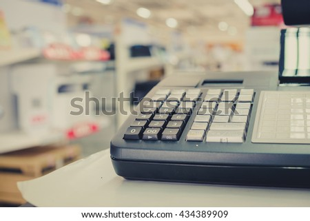 Close up one cash register with a bar code reader in department