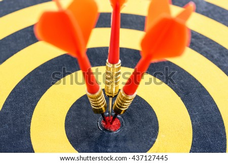 Close up one target with three dart arrows hitting the bullseye (center)(goals). Successful business strategy and marketing concept, Abstract success conceptual background - stock photo