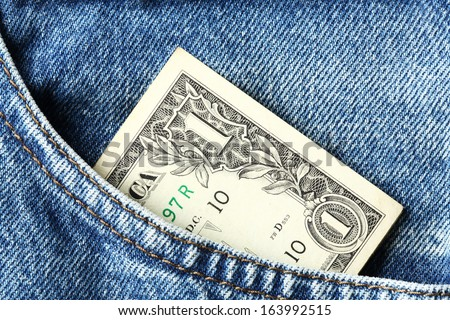 Close up one US dollar banknote in blue jeans pocket