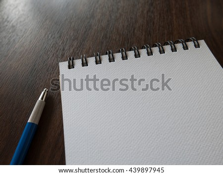 Close-up Open blank notebook with pencil, Selective focus - stock photo