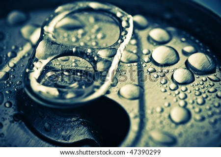 close up opened aliminium jar with water drops - stock photo