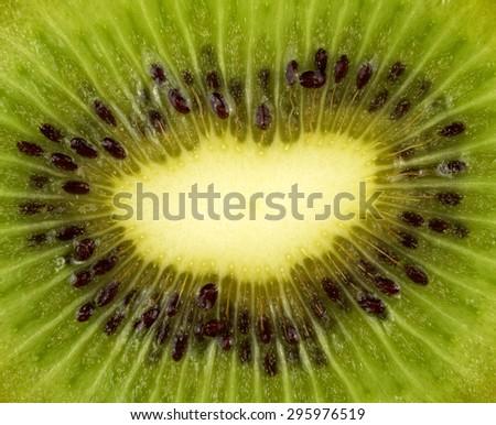 Close up or macro shot of Slice of fresh and ripe  kiwi fruit  - stock photo