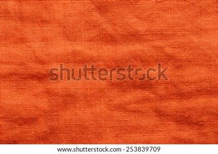 close up orange linen cloth background - stock photo
