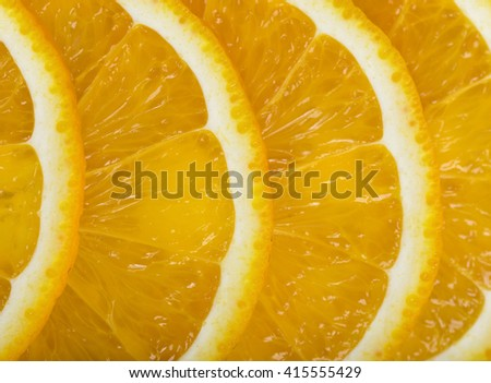 Close-up orange slices are in a row. Top view composition. Food decoration. Boosting immune system. Helps prevent ageing of skin. Protects your vision. - stock photo